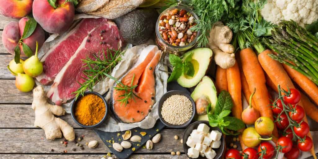 Balanced nutrition concept for clean eating flexitarian meditteranean diet. Assortment of healthy food ingredients for cooking on a kitchen table. Top view flat lay background